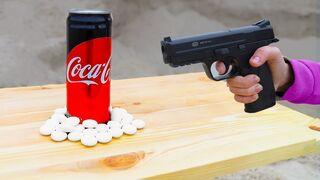 Coca Cola and Mentos vs Pistol